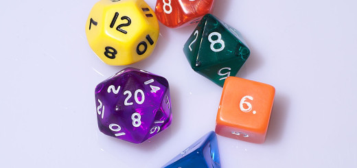 Six dice of various colours. 4-sided die, 6-sided die, 8-sided die, 10-sided die, 12-sided die and 20-sided die